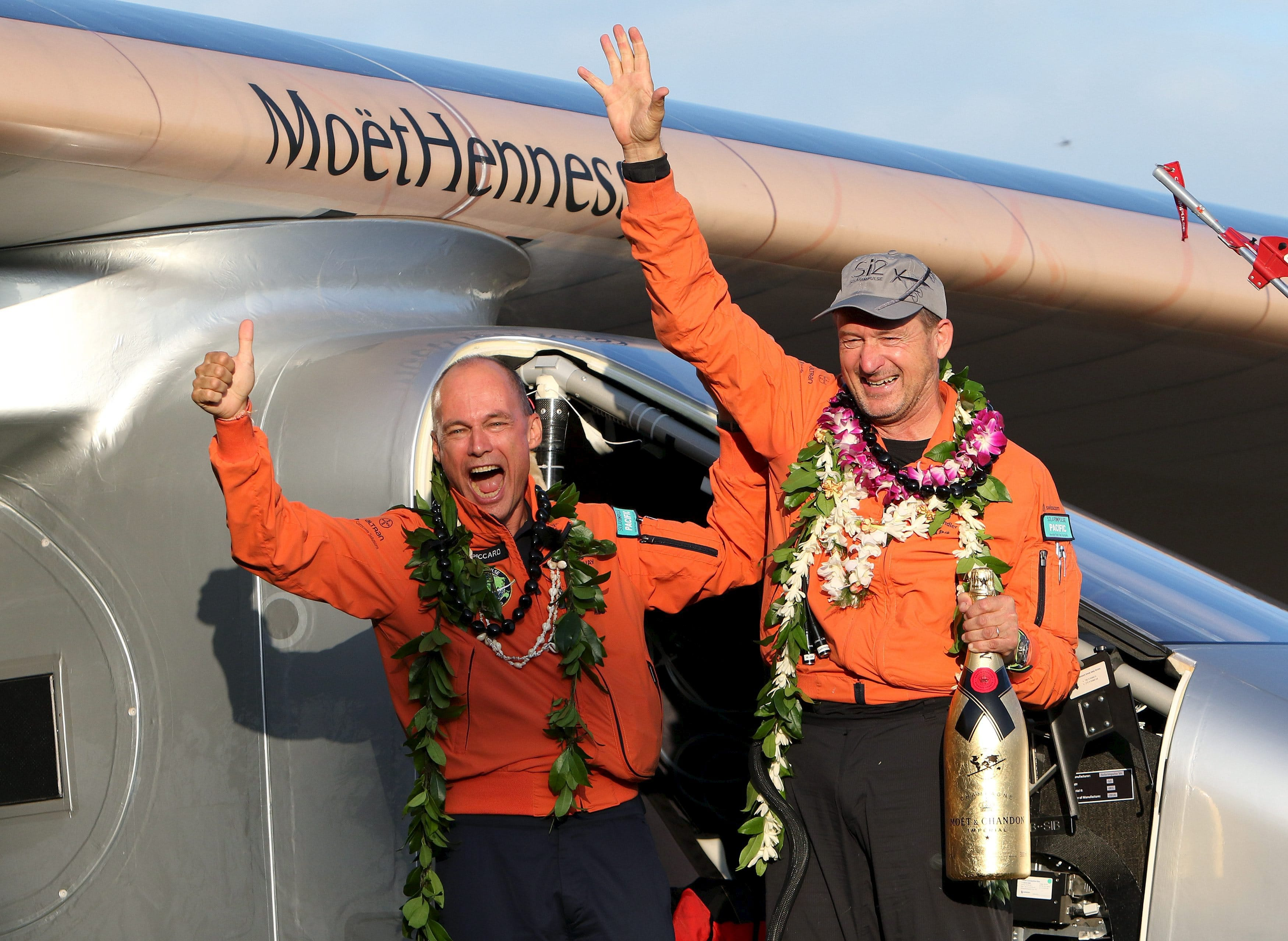 Bertrand Piccard (L) celebrates with Andre Borschberg after the Solar Impulse 2 airplane, piloted by Borschberg, landed at Kalaeloa airport after flying non-stop from Nagoya, Japan, in Kapolei, Hawaii, July 3, 2015. The aircraft, powered only by the sun's energy and piloted alternatively by Swiss explorers Borschberg and Piccard, has broken a world record for the longest non-stop solo flight, the project team said on Thursday. REUTERS/Hugh Gentry TPX IMAGES OF THE DAY