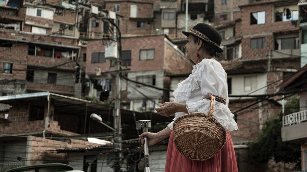 woman in traditional clothes in the streets of Comuna 13