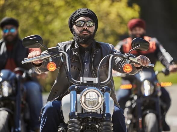 three men ride motorcycle wearing Tough Turban